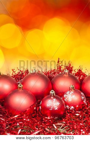 Xmas Red Bauble On Blurred Red Yellow Background