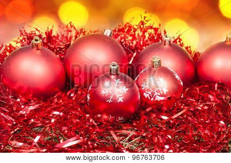 Xmas Red Baubles And Tinsel On Red Background
