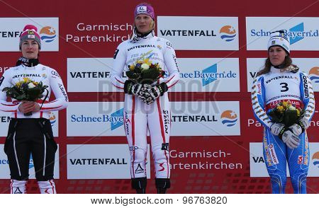 GARMISCH PARTENKIRCHEN, GERMANY. Feb 19 2011: Kathrin Zettel (AUT) (L) 2nd, Race winner Marlies Schild (AUT) (C) and Maria Pietilae-Holmner (SWE) (R) 3rd during the flower ceremony of the slalom race