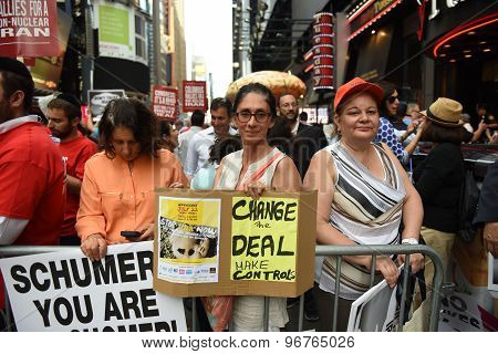 Activists in Times Square with signs