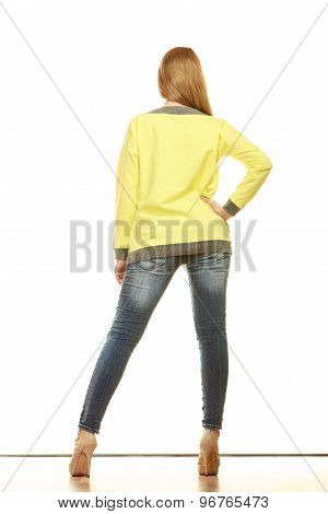 Woman In Denim Pants High Yellow Shirt Back View