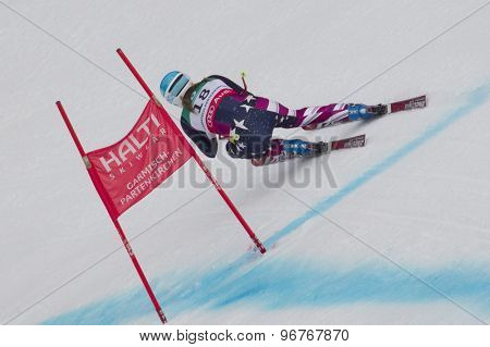 GARMISCH PARTENKIRCHEN, GERMANY. Feb 13 2011: Julia Mancuso (USA) speeds down the course competing in the women's downhill race at the 2011 Alpine skiing World Championships