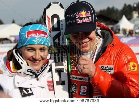 GARMISCH PARTENKIRCHEN, GERMANY. Feb 13 2011: Downhill world champions Elisabeth Goergl (AUT) (L) and Erik Guay (CAN) (R) in the finish area of the women's downhill race
