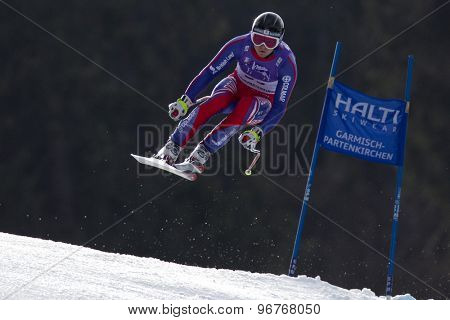 GARMISCH PARTENKIRCHEN, GERMANY. Feb 12 2011: TJ Baldwin (GBR) takes to the air competing in the men's downhill at the 2011 Alpine skiing World Championships