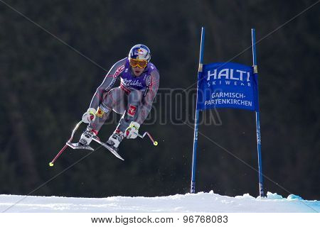GARMISCH PARTENKIRCHEN, GERMANY. Feb 12 2011: Erik Guay (CAN) the race winner takes to the air competing in the men's downhill at the 2011 Alpine skiing World Championships