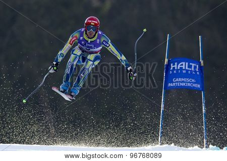 GARMISCH PARTENKIRCHEN, GERMANY. Feb 12 2011: Andrej Jerman (SLO) takes to the air competing in the men's downhill at the 2011 Alpine skiing World Championships