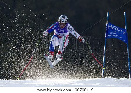 GARMISCH PARTENKIRCHEN, GERMANY. Feb 12 2011: Peter Fill (ITA) takes to the air competing in the men's downhill at the 2011 Alpine skiing World Championships