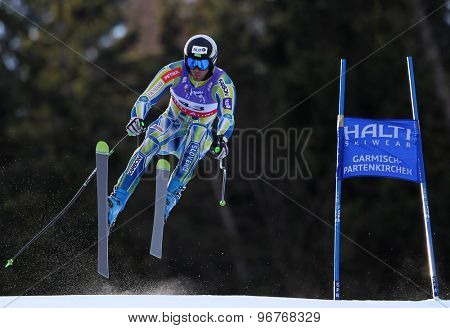 GARMISCH PARTENKIRCHEN, GERMANY. Feb 10 2011: Gasper Markic (SLO) takes to the air competing in the men's downhill training at the 2011 Alpine Skiing World Championships