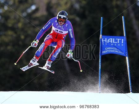 GARMISCH PARTENKIRCHEN, GERMANY. Feb 10 2011: Ed Drake (GBR) takes to the air competing in the men's downhill training at the 2011 Alpine Skiing World Championships