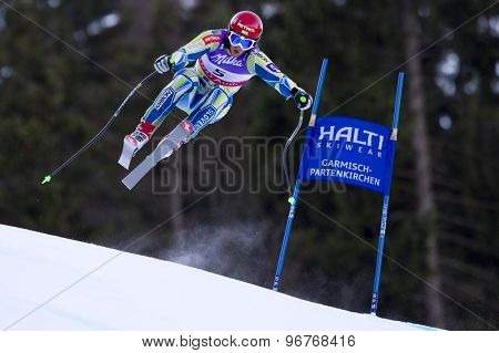 GARMISCH PARTENKIRCHEN, GERMANY. Feb 10 2011: Rok Perko (SLO) takes to the air competing in the men's downhill training at the 2011 Alpine Skiing World Championships