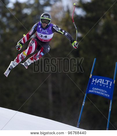 GARMISCH PARTENKIRCHEN, GERMANY. Feb 10 2011: Travis Ganong (USA) takes to the air competing in the men's downhill training at the 2011 Alpine Skiing World Championships