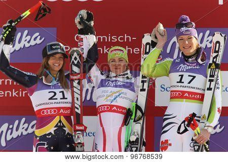 GARMISCH PARTENKIRCHEN, GERMANY. Feb 08 2011: Julia Mancuso second placed racer (L) Elisabeth Goergl (AUT) (C) winner and Maria Riesch (GER) (R)  at the 2011 Alpine skiing World Championships