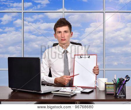 Businessman Holaing Clipboard
