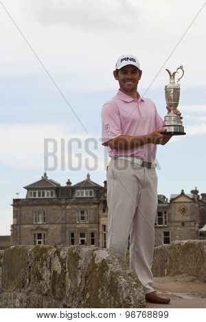 ST ANDREWS, SCOTLAND. July 19 2010: The Open Champion Louis OOSTHUIZEN from South Africa winner of the The Open Championship   on top of the Swilcan Bridge with the silver claret jug trophy.