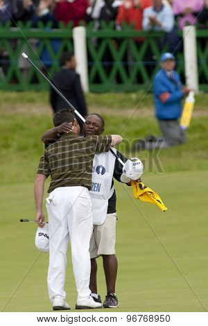 ST ANDREWS, SCOTLAND. July 18 2010: Louis OOSTHUIZEN from South Africa hugs his caddie after winning The Open Championship    played on The Royal and Ancient Old Course