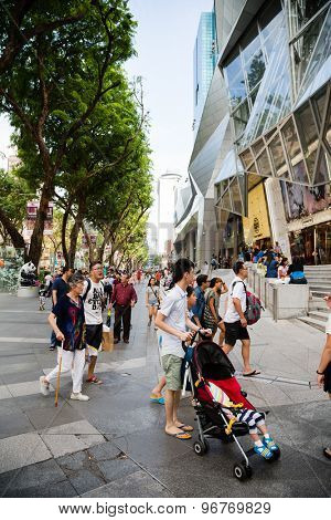 SINGAPORE - CIRCA FEBRUARY, 2015: People walk in the entertainment area at the mall ION Orchard - one the best shopping centers on Orchard Road. In the mall more than 300 shops of the famous brands.