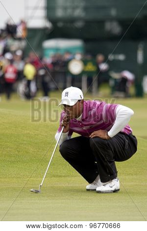 ST ANDREWS, SCOTLAND. July 15 2010: Tiger WOODS from the USA in action on the first day of The Open Championship   played on The Royal and Ancient Old Course