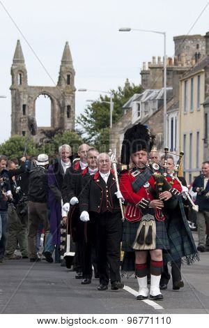 ST ANDREWS, SCOTLAND. July 13 2010: A piper leads the procession for the honorary awards to Padraig HARRINGTON Tom Watson, and Arnold Palmer