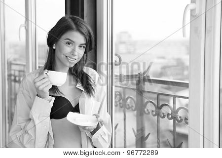 Young Sexy Woman Wearing Man's Shirt And Enjoying Her Morning Coffee