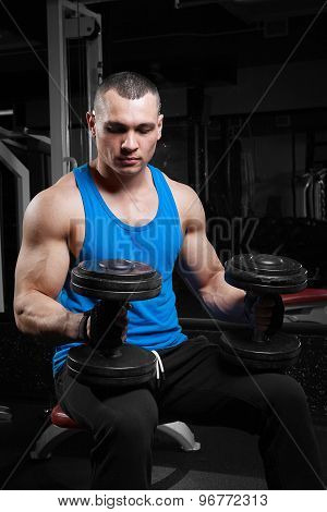 Athletic Guy Bodybuilder , Execute Exercise With Dumbbells