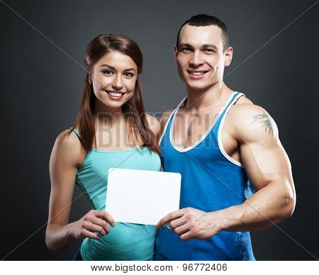 Couple Holding White Poster Together