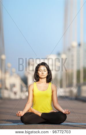 Beautiful Woman Doing Yoga On The Background Of The Urban Landscape