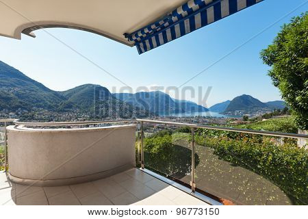 panoramic view from a terrace of a building, summer day