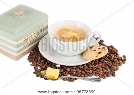 Coffee with added milk, buter and butter cookies served on cup and saucer