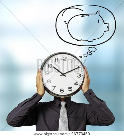 Businessman with alarm clock on head