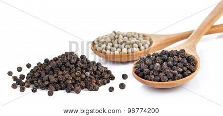 Peppercorn In The Wooden Spoon On White Background