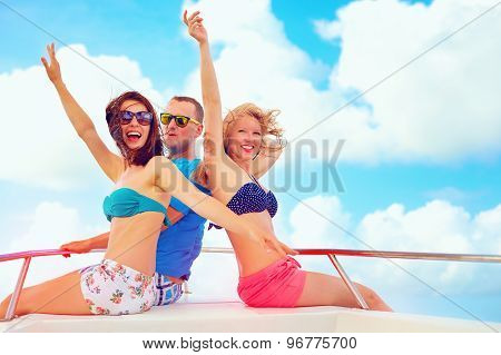 Group Of Happy Friends Having Fun On Yacht, During Summer Vacation