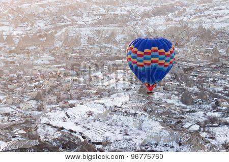 Hot air balloons fly over Cappadocia.