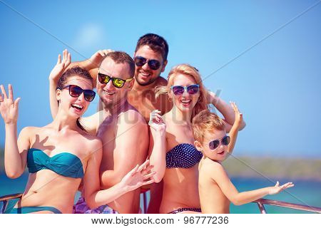 Group Of Happy Friends, Family Having Fun On Yacht, During Summer Vacation