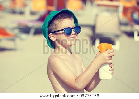 Little Kid Applying Sunscreen Spray