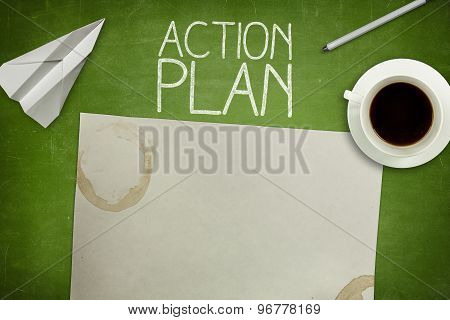 Action plan concept on green blackboard with empty paper sheet