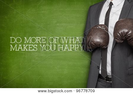 Do more of what makes you happy on blackboard with businessman