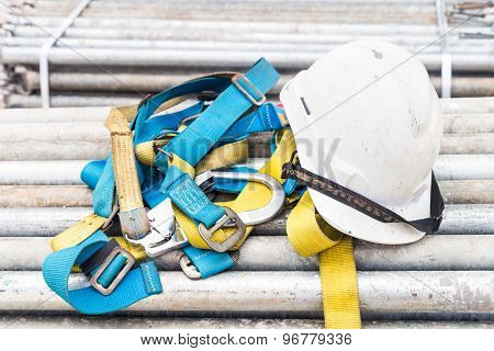 Safety helmet and harness equipment at a construction site
