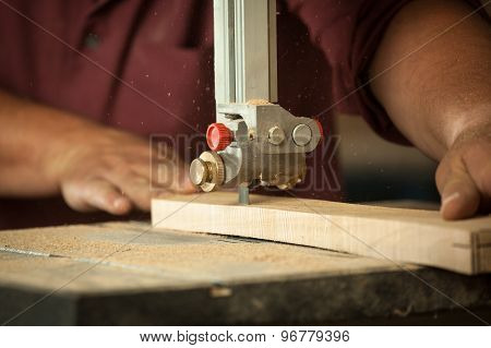 Professional Carpenter Working With Sawing Machine In Workshop.