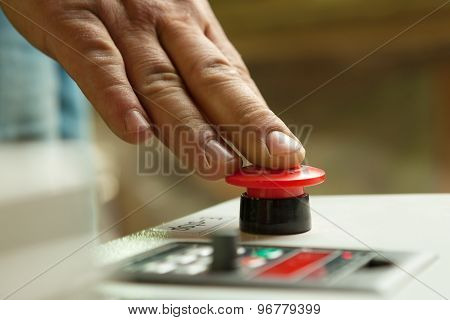 Male Hand Pushing Emergency Stop Button.