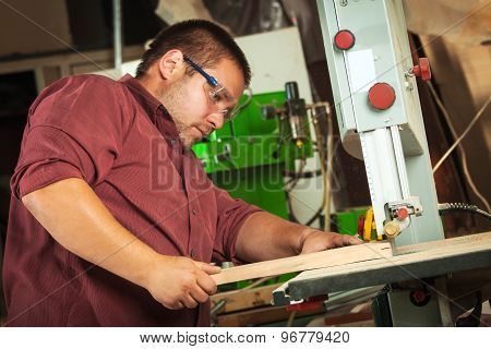 Professional Carpenter Working With Sawing Machine.