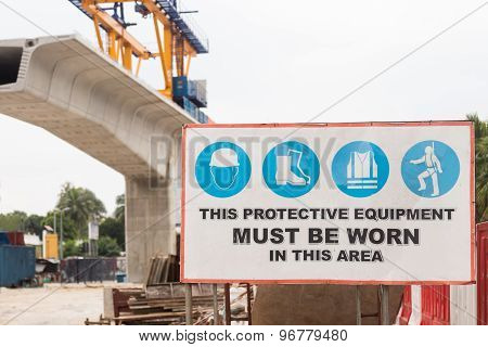 Safety signage board with construction site background