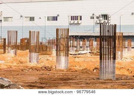 Foundation pillars and columns being built at construction site