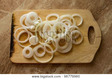 White Onion Rings Lie On A Marble Background