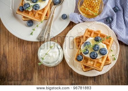 Homemade Fresh Crispy Waffles For Breakfast With Blueberries And Honey