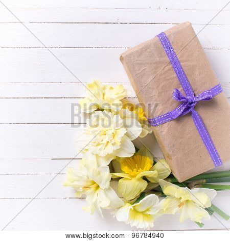 Spring Flowers Narcissus And Box With Present