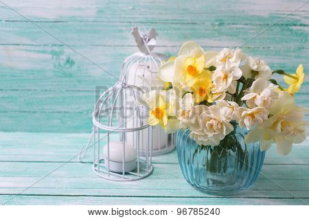 Bright narcissus flowers in blue vase
