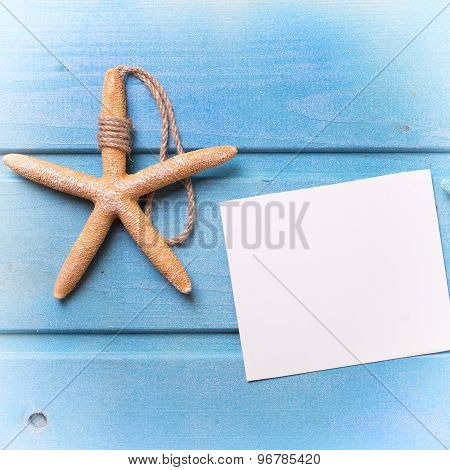 Marine Items And Tag On Blue Wooden Background.