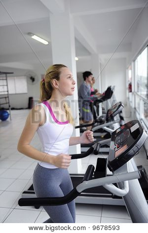 People Running On Treadmill At The Gym