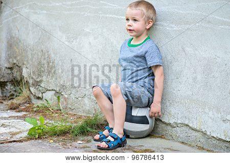 Boy sitting on a ball