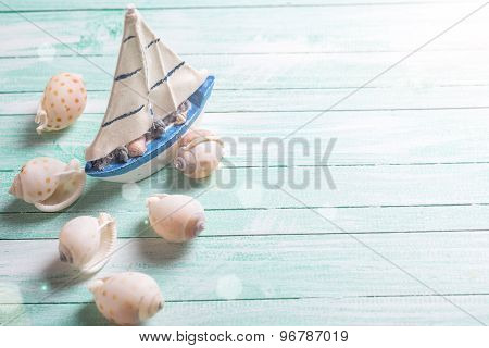 Decorative Sailing Boat And Marine Items On Wooden Background.